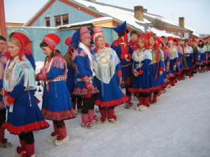 Sami procession in Norway. Sami reindeer herders are struggling to cope with changing weather patterns as a result of climate change. Photo: Olav Mathis Eira / Flickr.com