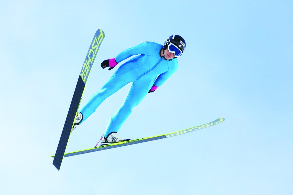 Photo: Mht54321 / Wikimedia Jessica Jerome in flight at the U.S. Olympic Team Trials in Park City, UT. Along with Lindssey Van and Sarah Hendrickson, she'll compete in the first Olympic women's ski jumping event.