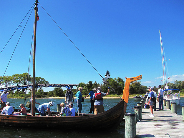 Photo: William De Roche The Viking ship arrives at St. Clement's Island. The lighthouse waits for them in the background.