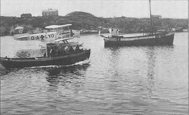 Photo courtesy of Jon Lind It was commonplace during the war for small boats to ferry people wanting to escape the Germans to England. The first such escape in our area involved the Snål, captained by Oskar Lairvåg. The Germans had gotten wind that something was afoot and sent a small seaplane to the area. Snål was scheduled to pick up two more men at Fonnes, but when the plane blocked the harbor they continued past, heading for the open ocean, and arrived in Shetland the following day. The photograph shows Snål (with escapees onboard) passing by the German plane with Fonnes in the background. Oskar returned, borrowed another boat, and transported his whole family to England. The man who lent him the boat, Ivar Duesund from Masfjorden, was arrested and executed by the Germans.