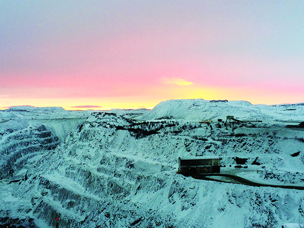 Photo: David Nikel Sunset over the Sydvaranger Gruve open-pit iron ore mine.