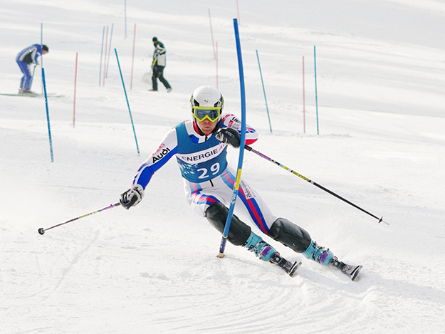 Photo: Christian Jansky / Wikimedia Commons French alpine skier Steven Théolier slaloms through a course in Austria.
