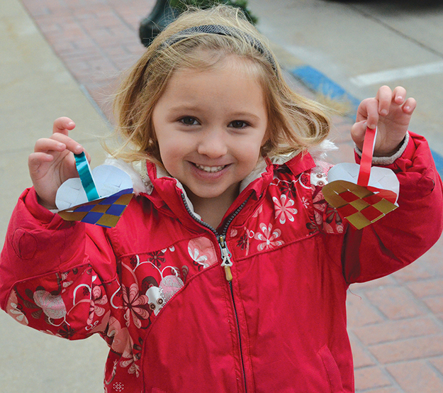 Photo courtesy of Vesterheim: Kids love making heart baskets during Vesterheim's Norwegian Christmas Celebration.