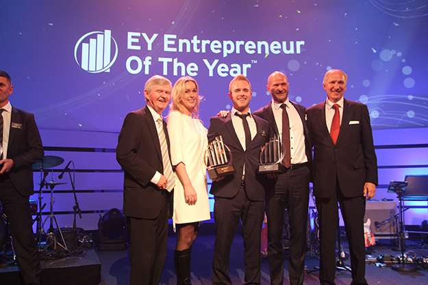 Photo courtesy of Norsafe  Alexander Skaala (Geir Skaala's son, center) accepting the Ernst & Young Entrepreneur of the Year award on behalf of his father.