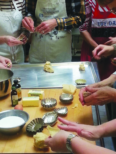 Photo courtesy of Jeremy Ehrlich / Nordic Heritage Museum Many hands make light cookies at Daytona Strong's baking class.