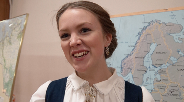 Photo: Aaron Hagström HVU youth Katrine Flunes wearing her bunad. She gave a talk about the traditional dress at the ceremonial dinner concluding NOREX.