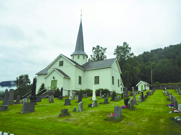 Photo: Asgeir Enersen / Wikimedia Commons Øyer Kirke, an 18th century replacement for the site's original stave church.