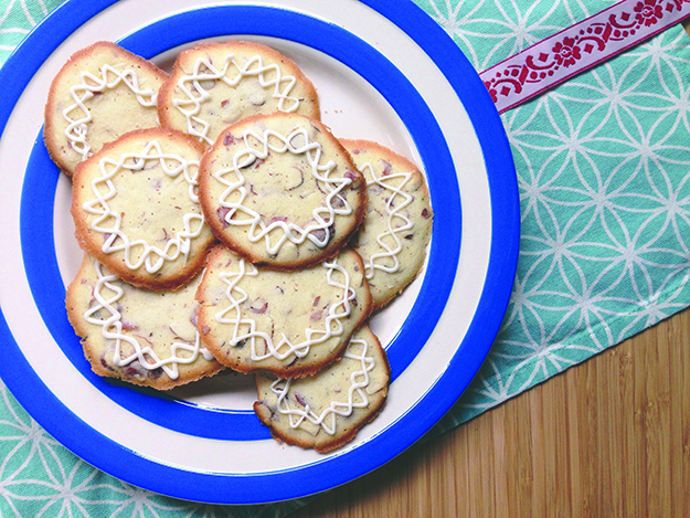 Photo: Dianna Walla Inspired by kransekake, icing gives these almond cookies a festive touch.