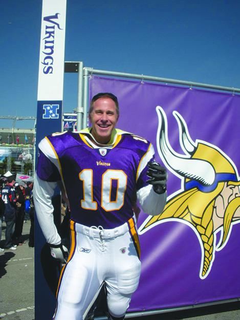 Photo: Michael Dorausch / Flickr Fan Michael Dorausch tries on a Minnesota Vikings uniform outside Dolphins Stadium at Super Bowl Sunday XXIV.