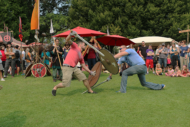 Photo: Solveig Lee Clockwise from top: Modern-day Vikings battle it out with (wooden) swords and shields.