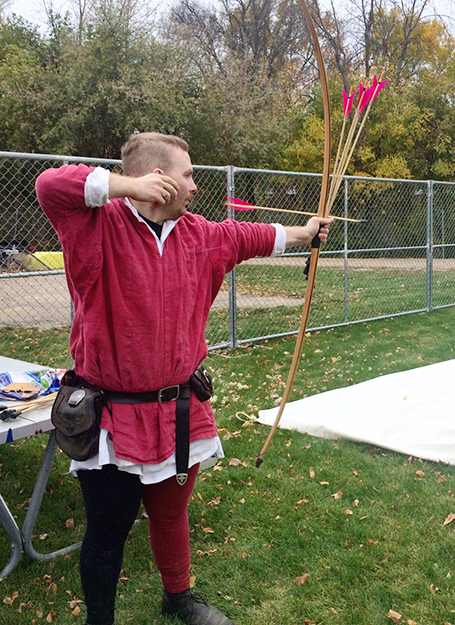 Photo: Amy Lietz Archer and master bow-maker Cameron James Alexander Christian-Weir of Grey Goose Bows demonstrates how to shoot one of his creations.