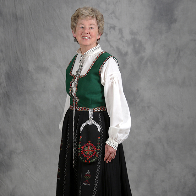 """Photo courtesy of Gloria Koll """"My bunad was made by a relative ... who lives in the Nordfjord region. She had it ready for me at her home so that I could wear it to her daughter's wedding in Skei i Jølster in 2004,"""" said Koll."""