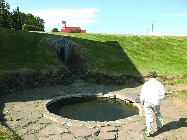 Photo: Terje Birkedal Snorri's stone hot tub at Reykholt. The door and stone stairs once led into his fortified household compound, which is now an archaeological site. He ran through this door just before his death.