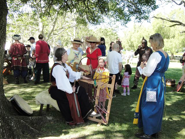 Photo courtesy of Judith Gabriel Vinje Dressed in her garb, Judith demonstrates weaving at a festival.
