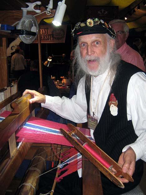 Photo: Barbara K. Rostad Don Karsky, a staple at Høstfest for years, is weaving his colorful ethnic flag products, such as placemats and table runners. Here he produces a Norwegian flag motif.