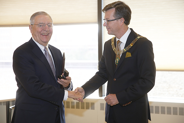 Photo: Tim Rummelhoff / courtesy of the University of Minnesota Law School Former Vice President Walter F. Mondale receives the Diploma and the Ring from Rector Dag Rune Olsen, the University of Bergen, in a celebration at the University of Minnesota.