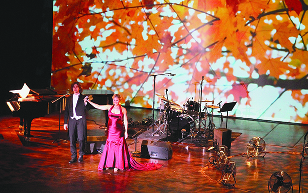 Photo: Benedicte Bjerknes, Royal Norwegian Embassy Ole Christian Haagenrud, piano, and Eli Kristin Hanssveen, soprano, performed in front of projected images, which were used throughout the evening to great effect.