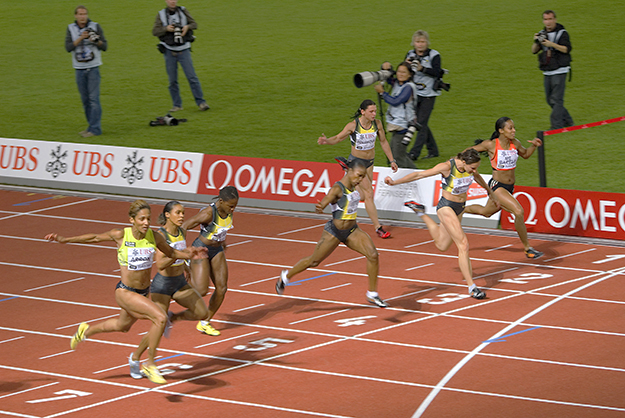 Photo: Beat / Wikimedia Commons  The finish of the women's 100 meter sprint at Golden League 2007, Zurich. Are these runners jumping or falling?