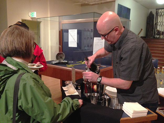 Photo: Gloria Chenoweth / Nordic Heritage Museum Sune Sandling takes a turn bartending at Seattle's opening of the Skål! exhibit at the Nordic Heritage Museum.