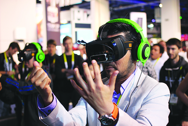 Photo: Maurizio Pesce / Flickr Virtual reality headsets like this one allow people to travel without leaving their homes.