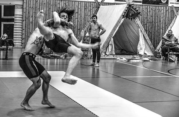 Photo: Egil Scott Synnestvedt / courtesy of Norwegian Glima Association One wrestler defeats another in a match in the Norwegian Championships, November 2015.