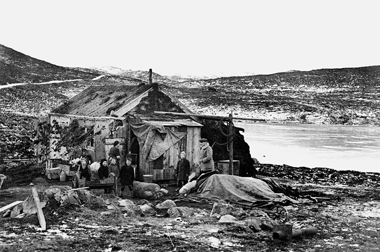 Photo courtesy of the Norwegian Defense Museum, Oslo Those who escaped the evacuation of Finnmark survived the winter in makeshift homes made out of destroyed boats, driftwood and rags, like this one, Oswald Johansen's hut at Tverrikvannet. The first night after the burnings 40 people sheltered in here in a space of 20 square meters.