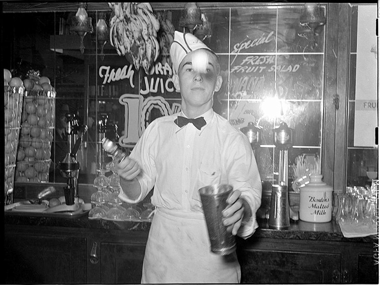 Photo: Public Domain / Wikimedia Commons A soda jerk flips ice cream into malted milk shakes in Corpus Christi, Texas, in Feb. 1939. These shops were once everywhere and embody the particular brand of Americana celebrated at Vanse's annual American Festival.