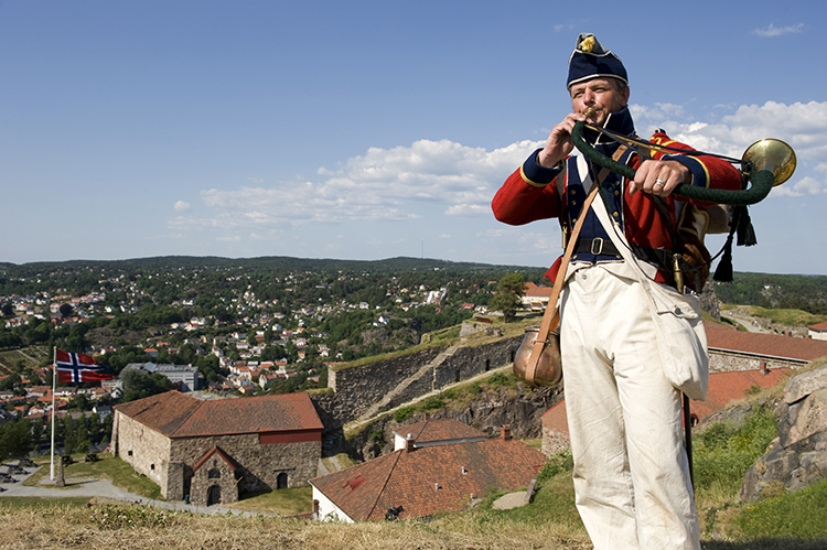Photo: Terje Rakke / Nordic Life AS /  Visitnorway.com A reenactor at the Fredriksten Fortress makes history come alive.
