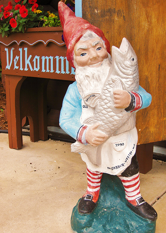 Photo: Eric Dregni    This small statue in front of a Norwegian stabbur in Westby, Wisconsin, shows a nisse named Ole bringing a gift of fish. Although the writing on the statue claims that it's lutefisk, the little fellow's apron would be more slimy if that were the case. Perhaps a taco shell is in order?