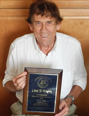 Olaf Engvig holding the 2015 Outstanding Scandinavian American Award