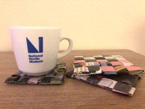 National Nordic Museum mug on a coaster made of recycled materials
