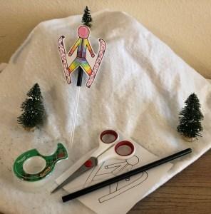 a paper ski jumper doll