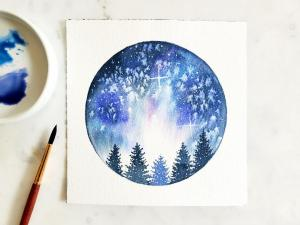 a water colored starry night sky with pine tree silhouettes