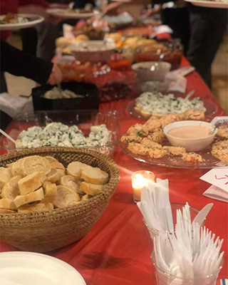 a table full of food for an NACC holiday party