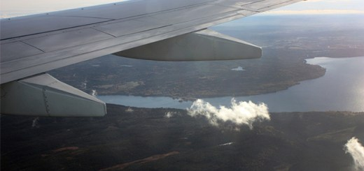 plane wing looking out over Norway