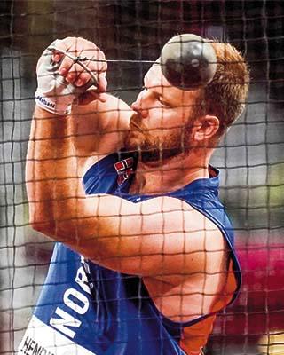 Eivind Henriksen winds up during the hammer throw