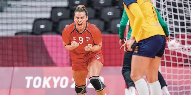 Nora Mørk celebrates scoring a goal