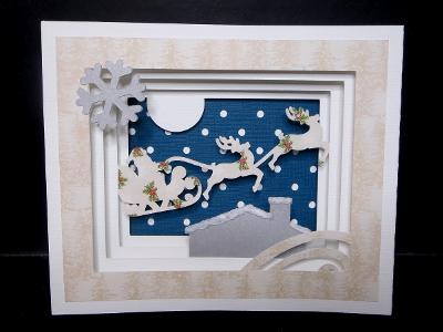 Une carte décoration Père Noël et son traineau