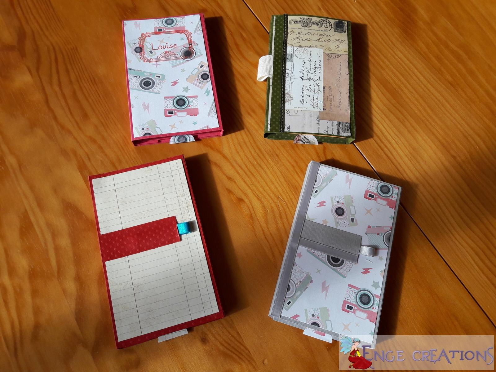 Nos 4 bloc-notes. De gauche à droite en partant du haut : ma 2ème version, celle d'Isabelle, celle de Marie-Pascale et celle de Mini-Enge.