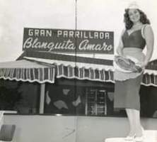 May be an image of 1 person, standing and text that says 'GRAN PARRILLADA Blanquita amaro'