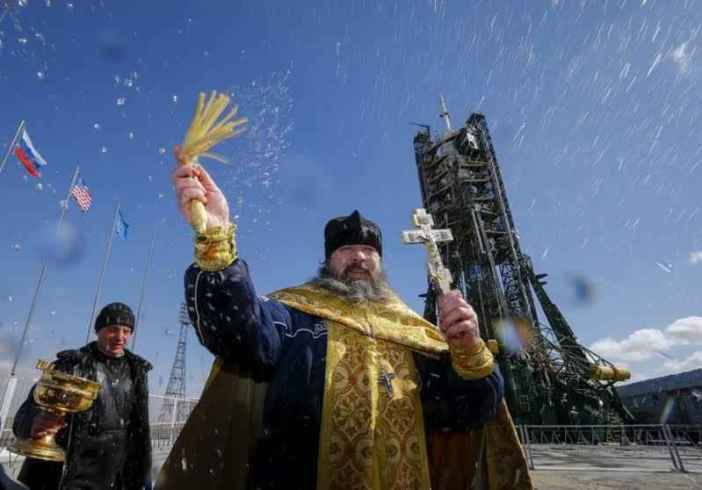 An Orthodox priest conducts a blessing in front of the Soyuz TMA-20M for the next International Space Station (ISS) crew, comprised of Jeff Williams of the U.S. and Oleg Skriprochka and Alexey Ovchinin of Russia, at the launchpad at the Baikonur cosmodrome, Kazakhstan, March 17, 2016, ahead of its launch scheduled on March 19. (REUTERS/Shamil Zhumatov)