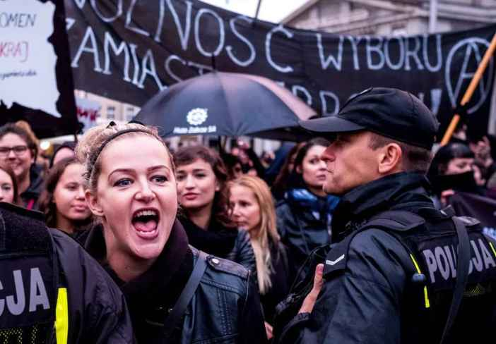 epa05568708 Protesters gather on the streets during the nationwide women strike in Katowice, Poland, 03 October 2016. Despite the heavy rains thousands of women and men protested to express their opposition to strengthen the regulations on the abortion law. Black-clad opponents of government plans to ban abortion staged a 'Black Monday'. Thousands of women took a day off from work to express their solidarity and fight for the entitlement to legal abortion, sex education, contraception and in vitro conception.  EPA/Andrzej Grygiel POLAND OUT