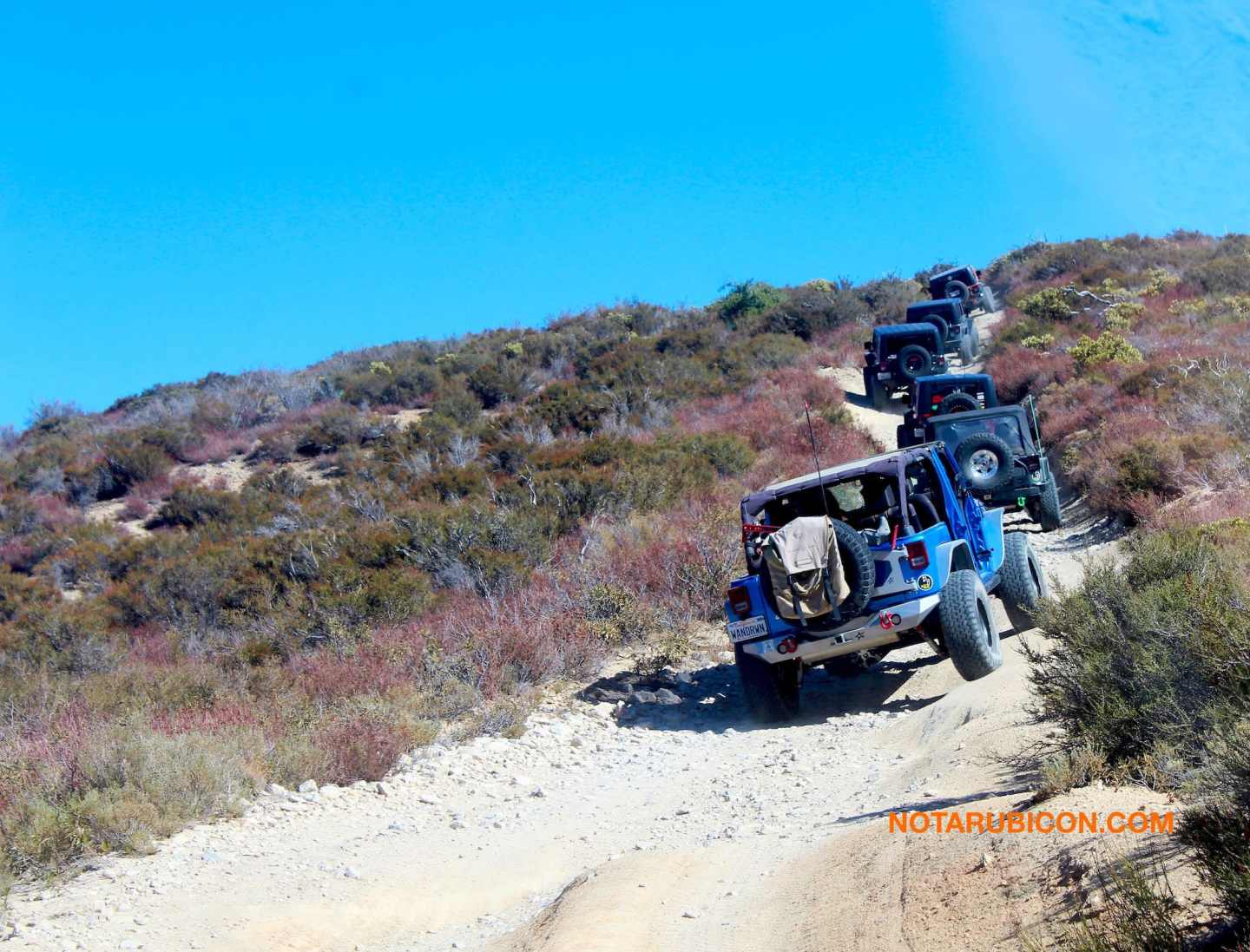 Jeeps going up a hill on Cleghorn Jeep trail