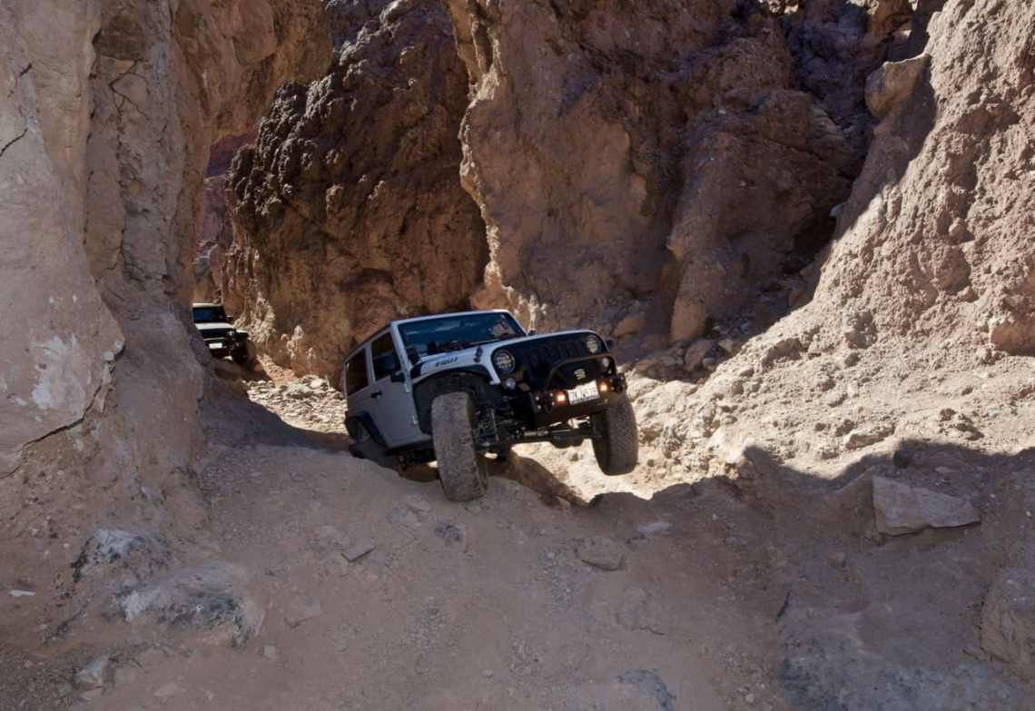 Jeep Wrangler on 3 wheels on Doran off-road trail near Calico