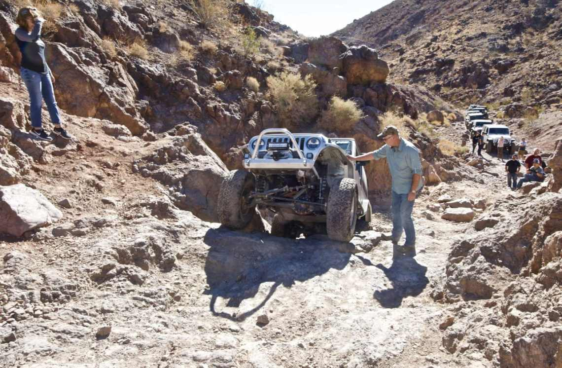 A Jeep TJ coming up a steep ledge on Doran Scenic Road near Calico Ghost Town