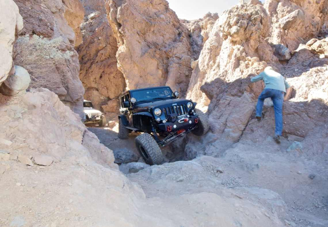 A Jeep Wrangler JK flexing on the rocks near Calico Ghost Town