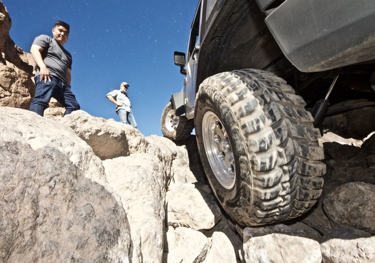 Jeep Wrangler tire going over a ledge on the off-road trail near Calico Ghost Town
