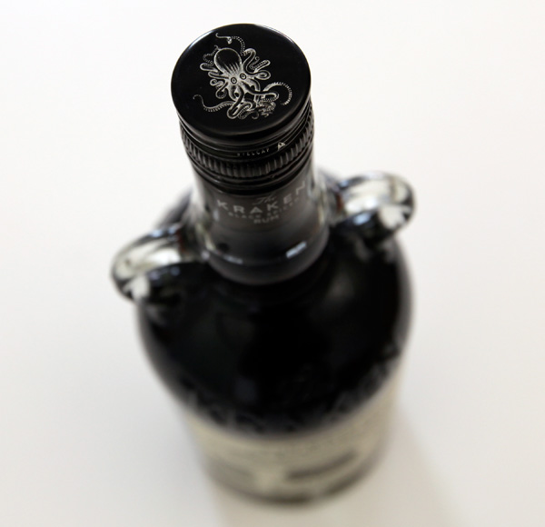 view looking down at the top of a bottle of rum with a kraken drawn on the lid