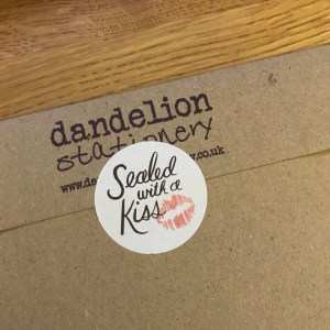 Sealed with a Kiss Sticker from Rifle Paper Co. featured on an envelope.