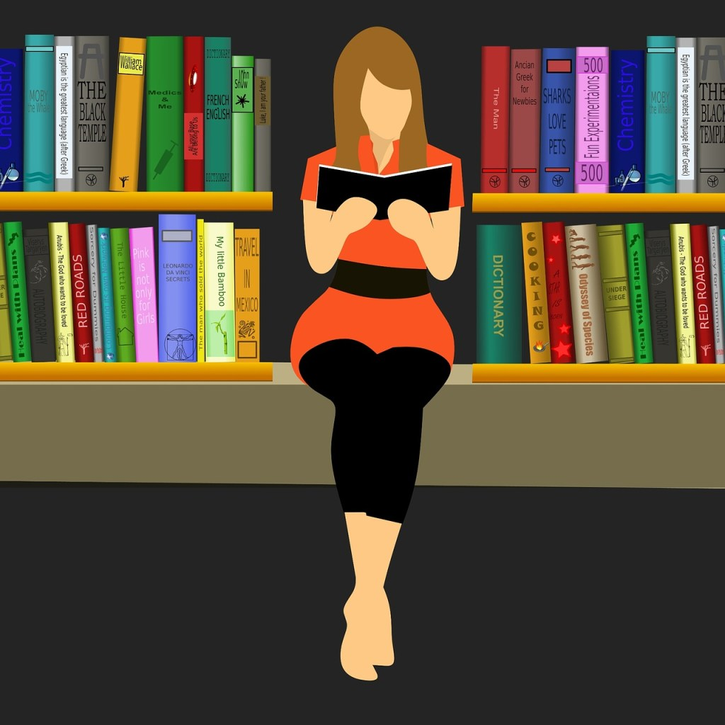 woman sitting & reading in front of book shelves